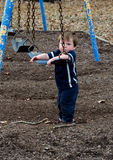 Sad little boy at the playground Royalty Free Stock Image