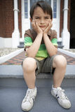 Sad Little Boy Sitting On Front Steps Royalty Free Stock Photos