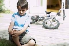 Sad Little Boy Sitting On Porch Of House Royalty Free Stock Photo