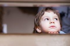 Sad little boy thinking looking up Stock Photos