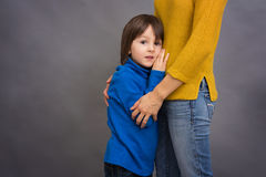 Sad little child, boy, hugging his mother at home, imag. E, copy space. Family concept Stock Images