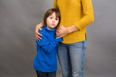 Sad little child, boy, hugging his mother at home, imag. E, copy space. Family concept Stock Photos