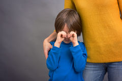 Sad little child, boy, hugging his mother at home, isolated imag. E, copy space. Family concept Stock Photography