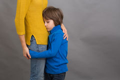 Sad little child, boy, hugging his mother at home, isolated imag Royalty Free Stock Photography