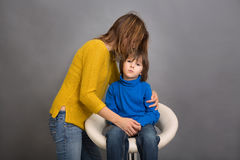 Sad little child, boy, hugging his mother at home, isolated imag Royalty Free Stock Photo