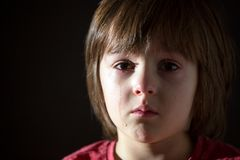 Sad little child, crying, hugging stuffed toy royalty free stock image