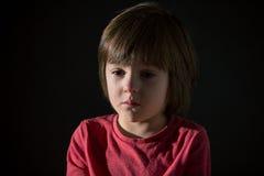 Sad little child, crying, hugging stuffed toy Stock Photography