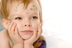 Sad little child with painted faces Royalty Free Stock Image