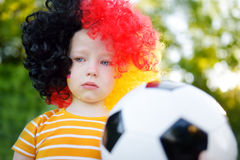 Sad little german child crying over her national football team's loss Royalty Free Stock Photo