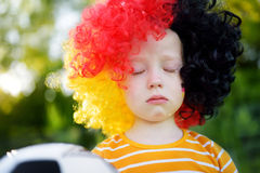 Sad little german child crying over her national football team's loss Stock Images
