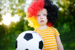 Sad little german child crying over her national football team's loss Stock Photography