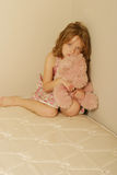 Sad little girl. Looking neglected with a teddy bear Royalty Free Stock Photo