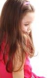 Sad little girl. Isolated on white background Royalty Free Stock Images