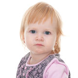 Sad little girl. A portrait of a sad blond pretty little girl; isolated on the white background Stock Photo