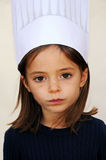 Sad little girl. With chefs hat Royalty Free Stock Photography