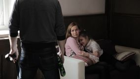 Sad little girl is afraid of drunken father parent, mother protects the child. Mother and daughter suffering from. Mother and daughter suffering from domestic stock video
