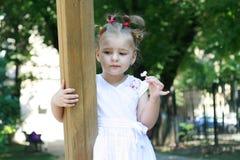 Sad little girl alone in park Stock Image