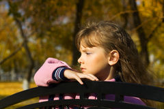 Sad little girl in autumn park Royalty Free Stock Photography