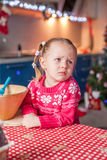 Sad little girl baking Christmas gingerbread Stock Photography