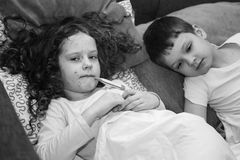 Sad little girl and boy with chickenpox. Black and white portrait. Royalty Free Stock Photography