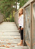 Sad little girl on bridge Stock Photography