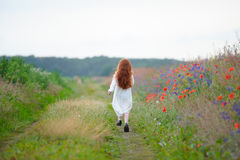 Sad little girl. Child`s problems. Kid walking alone outdoors. Royalty Free Stock Image
