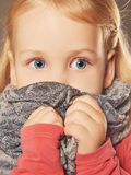 Sad little girl.children fear. Sad little girl in scarf.children fear Royalty Free Stock Images