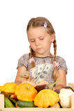Sad little girl counts money isolated on the whit Stock Photos