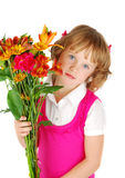 Sad  little  girl  with flowers. Royalty Free Stock Photo