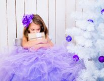 Sad little girl with a gift Stock Photo