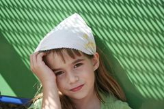 Sad little girl with green background Royalty Free Stock Image
