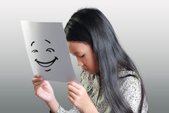 Sad Little Girl With Happy Face Mask Stock Photography