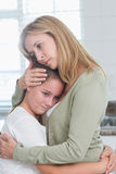 Sad little girl hugging her mother Stock Images