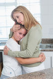 Sad little girl hugging her mother Stock Photos