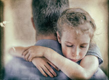 Sad little girl hugging his dad. Royalty Free Stock Photography