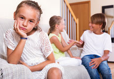 Sad little girl is jealous sister of stepbrother Royalty Free Stock Image