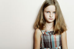 Sad little girl with long blond hair. Stock Images