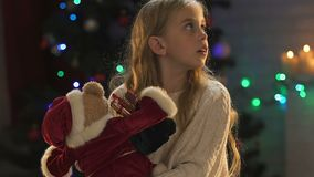 Sad little girl looking around, lack of parental attention lost faith in miracle. Stock footage stock footage
