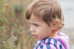 Sad little girl looks aside Stock Image