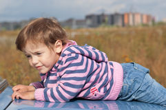 Sad little girl looks aside Stock Photography