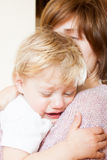 Sad little girl with mom Royalty Free Stock Photography