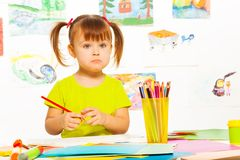 Sad little girl with pencil Royalty Free Stock Images