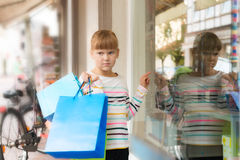 Sad little  girl pointing to shop window Royalty Free Stock Photography
