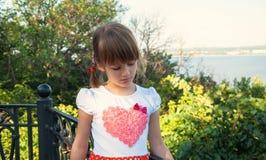 The sad little girl Stock Photo