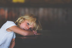 Sad little girl. Portrait of a sad blue eyed blond little girl Stock Photo