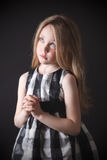 Sad little girl praying. Beautiful sad little girl making a wish Royalty Free Stock Image