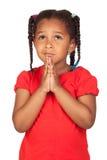 Sad little girl praying for something