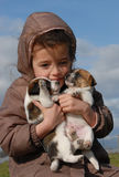 Sad little girl and puppies Royalty Free Stock Image