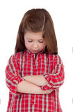 Sad little girl with red plaid shirt Royalty Free Stock Photos