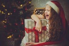 Sad child girl in Santa hat. royalty free stock images